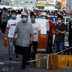 Beijing in 'wartime emergency' after new coronavirus cases linked to local market
