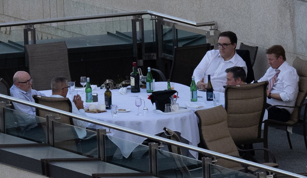 Concerns raised after photos of Alta. premier, ministers dining on Sky Palace rooftop emerge